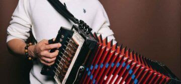 Andre Thierry holding an accordion